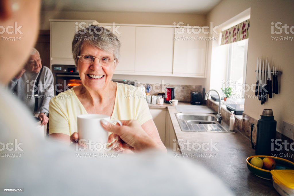 Senior Woman in her Kitchen stock photo