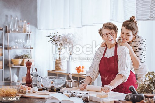 istock Senior woman in kitchen apron 892830826