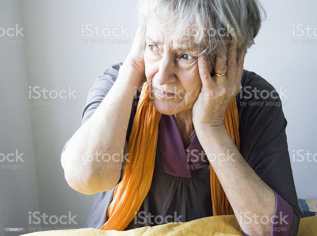 Senior Woman in Pain stock photo