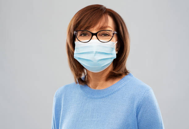 senior woman in protective medical mask stock photo