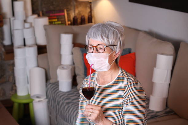 Senior woman in quarantine at home Senior woman in quarantine at home. quarantine stock pictures, royalty-free photos & images