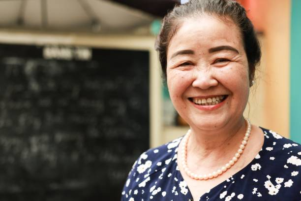 senior woman in south east asia Vietnamese senior woman is smiling. vietnamese ethnicity stock pictures, royalty-free photos & images