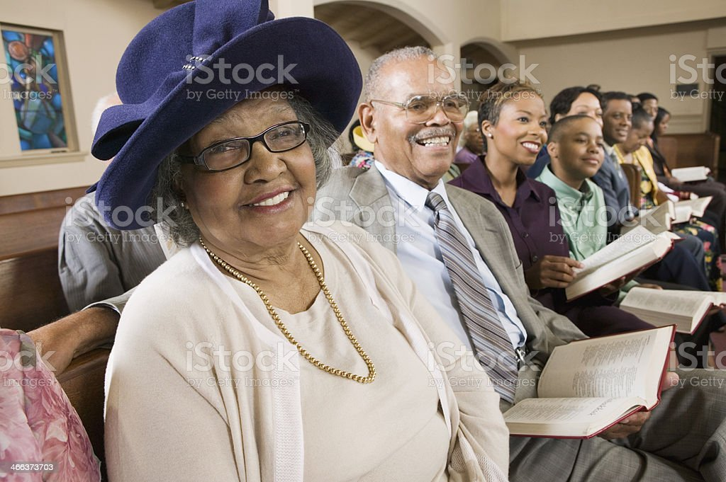 Senior Woman in Sunday Best at Church stock photo