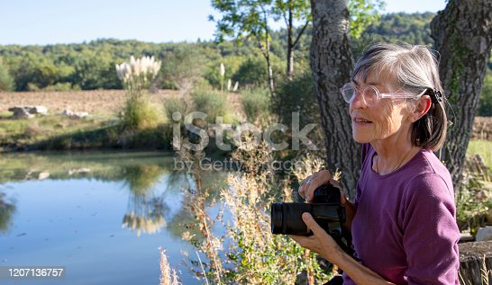 istock Senior woman in the countryside 1207136757