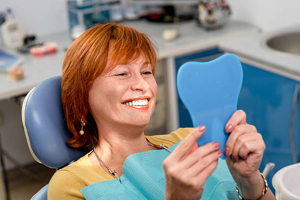 senior woman in the dental office. - dental implants stock photos and pictures