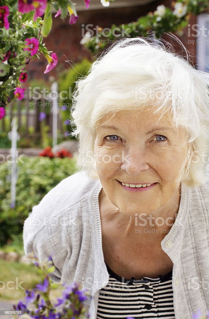 Senior woman in the garden royalty-free stock photo