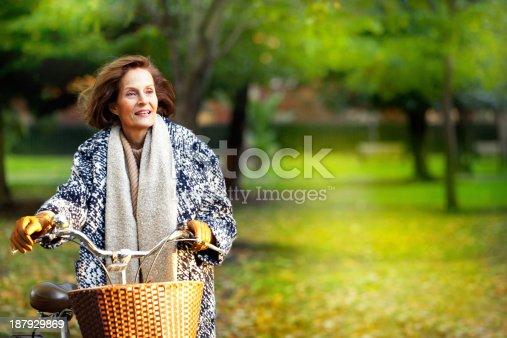 istock Senior woman in the park. 187929869