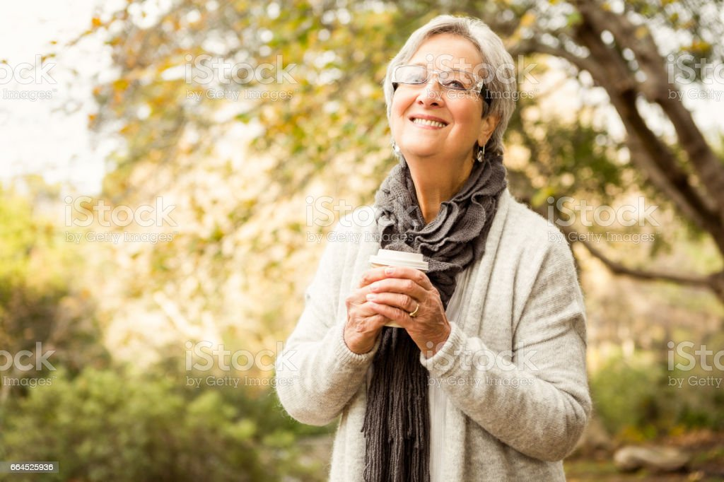 Senior woman in the park royalty-free stock photo