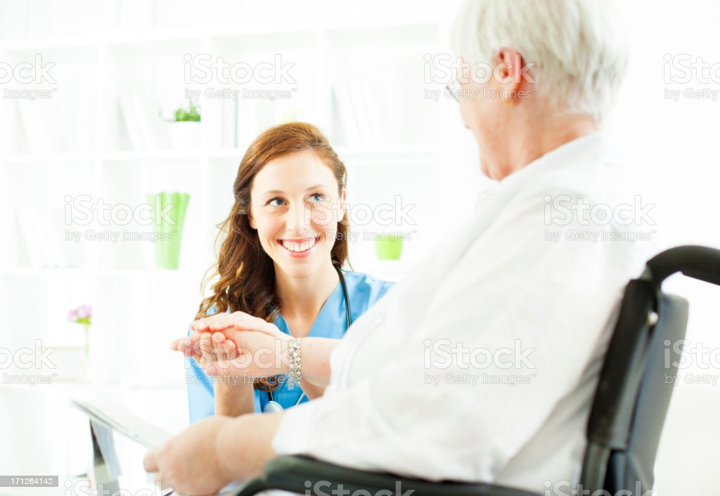 Senior Woman in wheelchair at doctors office. royalty-free stock photo