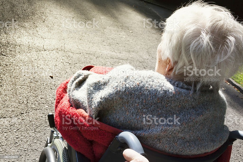 senior woman in wheelchair stock photo