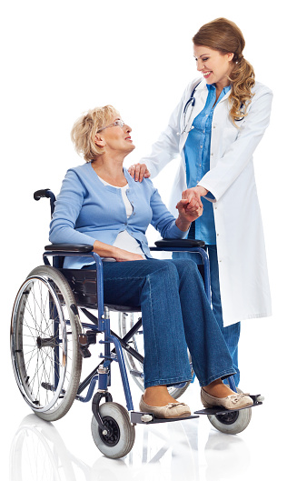 Senior Woman In Wheelchair With Doctor Stock Photo - Download Image Now