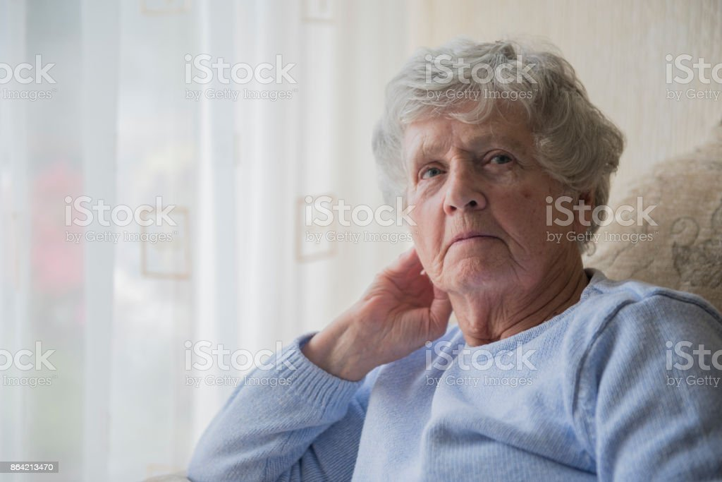 Senior woman indoors looking upset and bored royalty-free stock photo