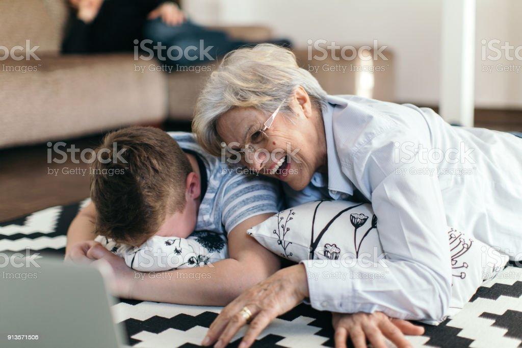 Senior woman is knitting sweather stock photo