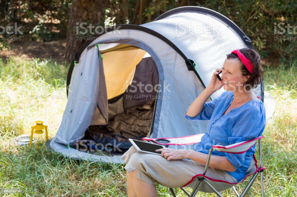 senior woman is talking on the phone royalty-free stock photo