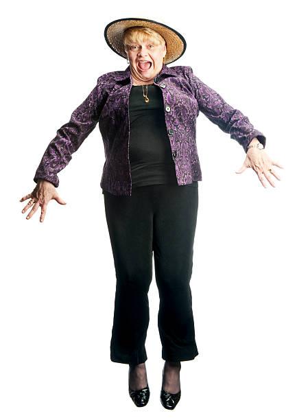 Senior Woman Jumping stock photo