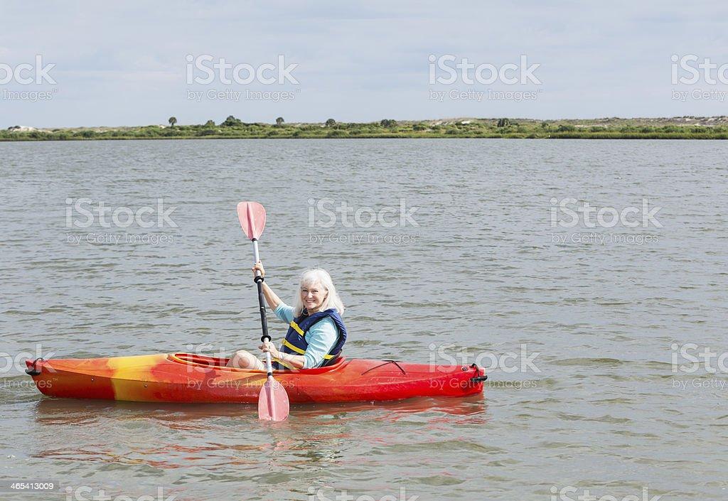 Senior Woman Kayaking On Intracoastal Waterway Florida Stock Photo