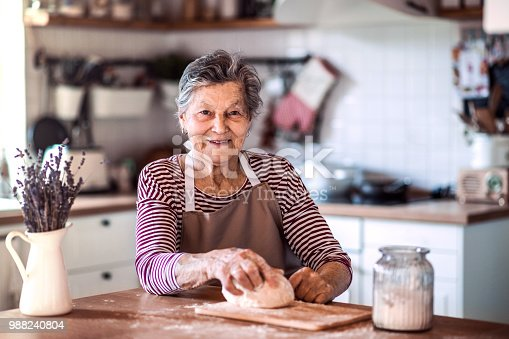 istock A senior woman kneading dough in the kitchen at home. 988240804