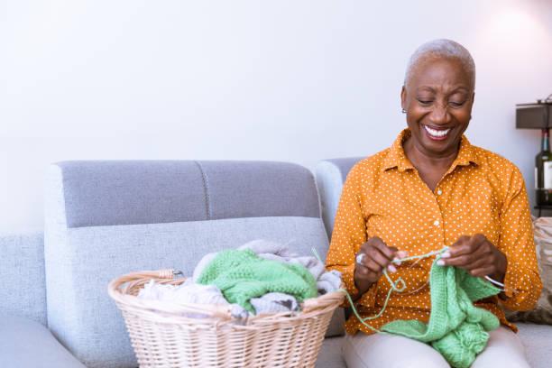 Senior Woman Knitting at Home stock photo