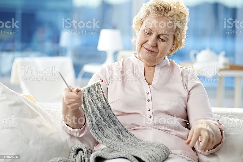 Senior woman knitting royalty-free stock photo
