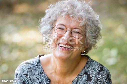 istock Senior woman laughing 612716922
