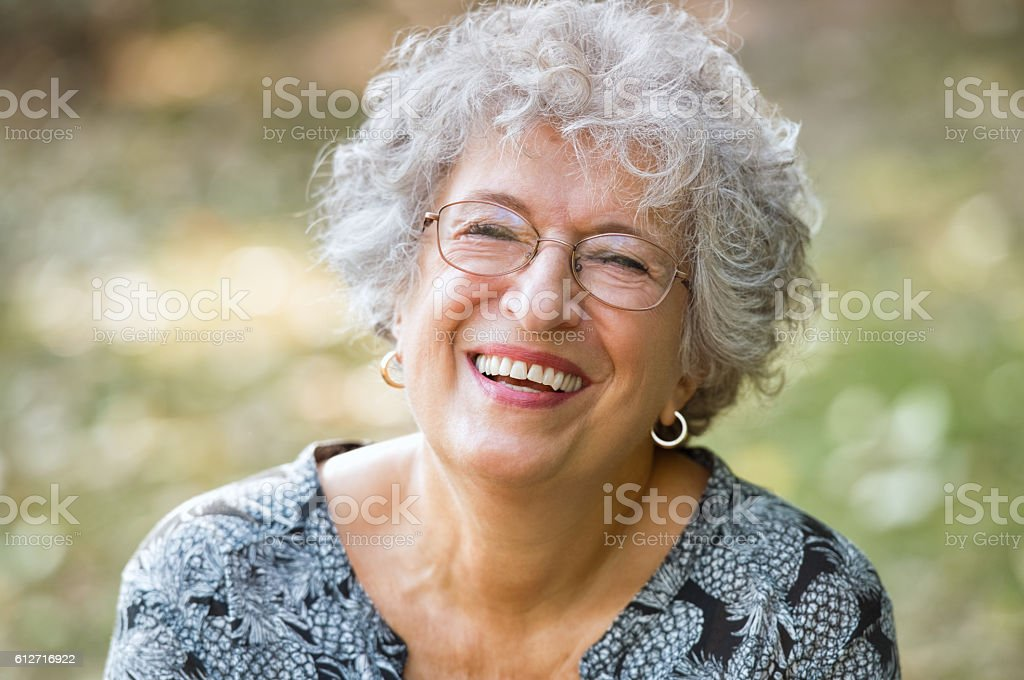 Senior woman laughing stock photo