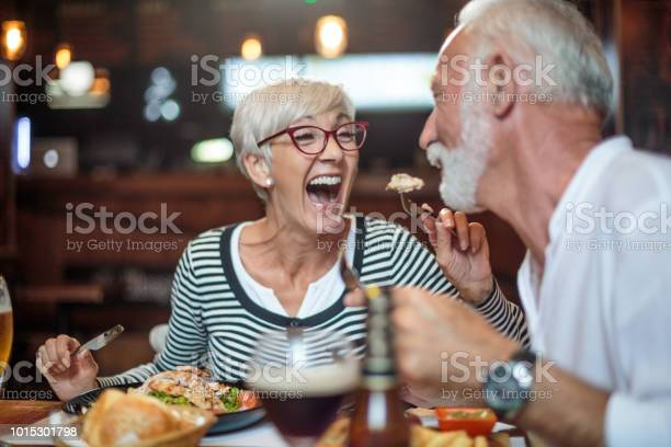 Senior woman laughing while feeding her male partner in the picture id1015301798?b=1&k=6&m=1015301798&s=612x612&h=rkoq2iuipemrts br2caqcepk51uapfkkagnjf3dxge=