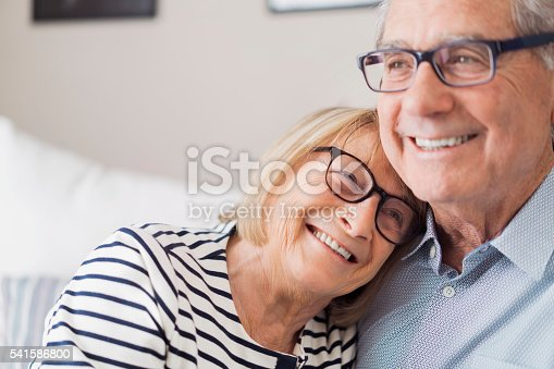 istock Senior woman leaning head on senior man's shoulder 541586800