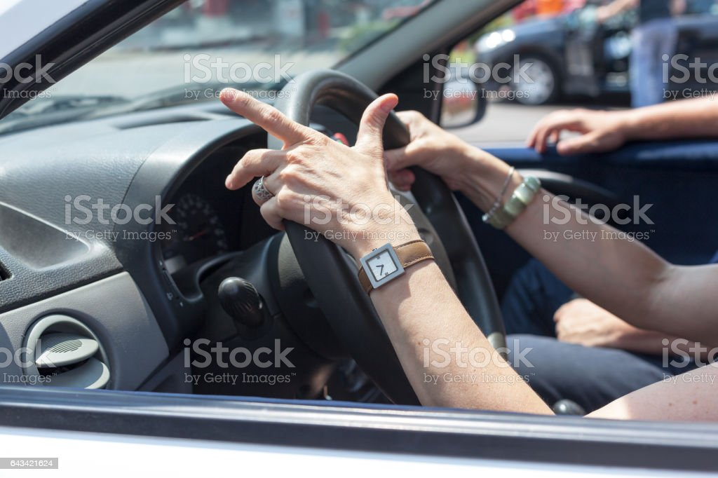 Senior woman learning to drive a car stock photo