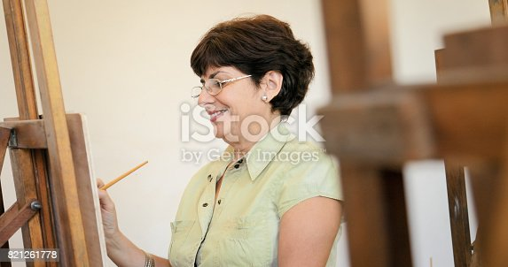 istock Senior Woman Learning To Paint At Art Lesson 821261778