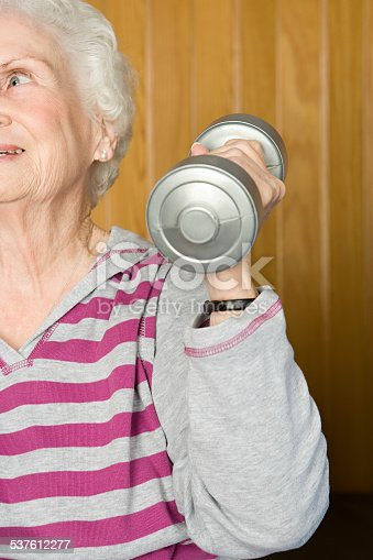 istock Senior woman lifting dumbbells 537612277
