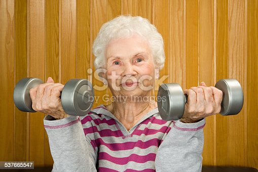 istock Senior woman lifting dumbbells 537665547