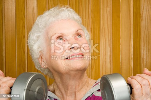 istock Senior woman lifting dumbbells 537665595