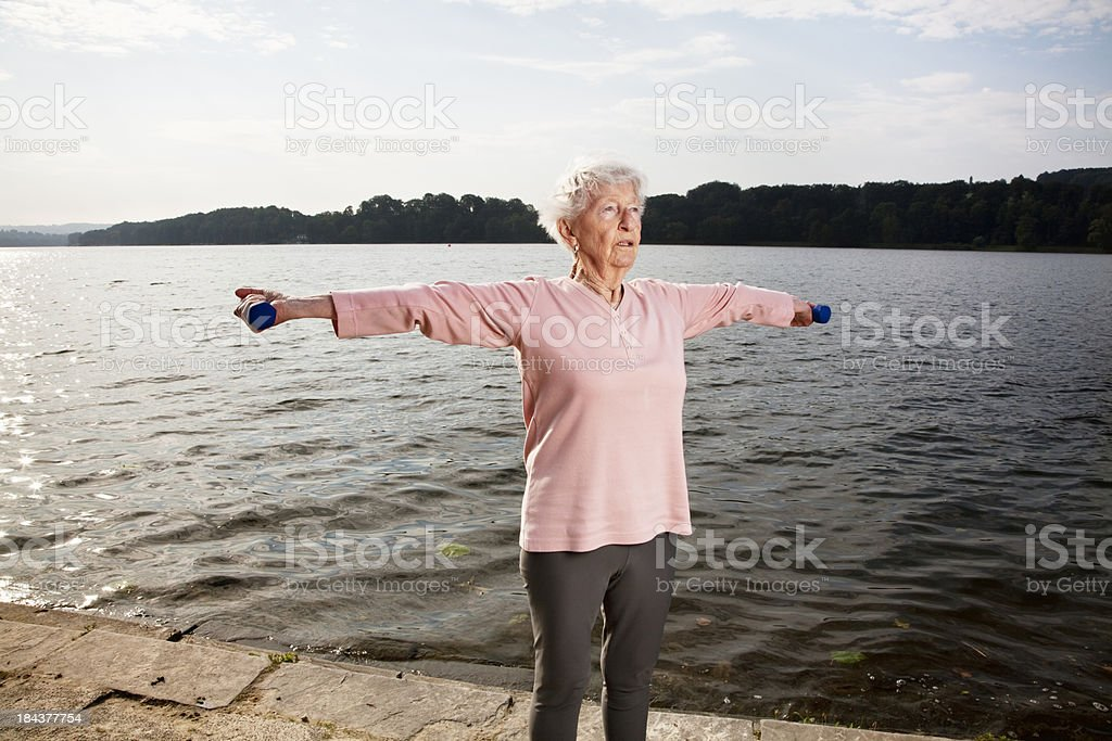 senior woman lifting dumbbels royalty-free stock photo