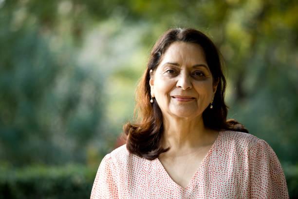 Senior woman looking at camera stock photo