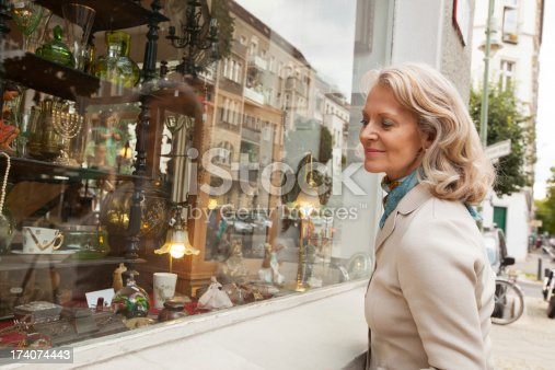 Senior woman looking at shopping windowhttp://bit.ly/183kyid