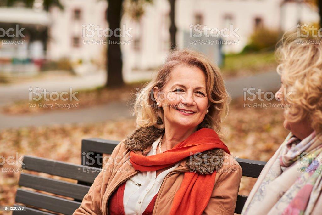 Senior woman looking at the camera stock photo