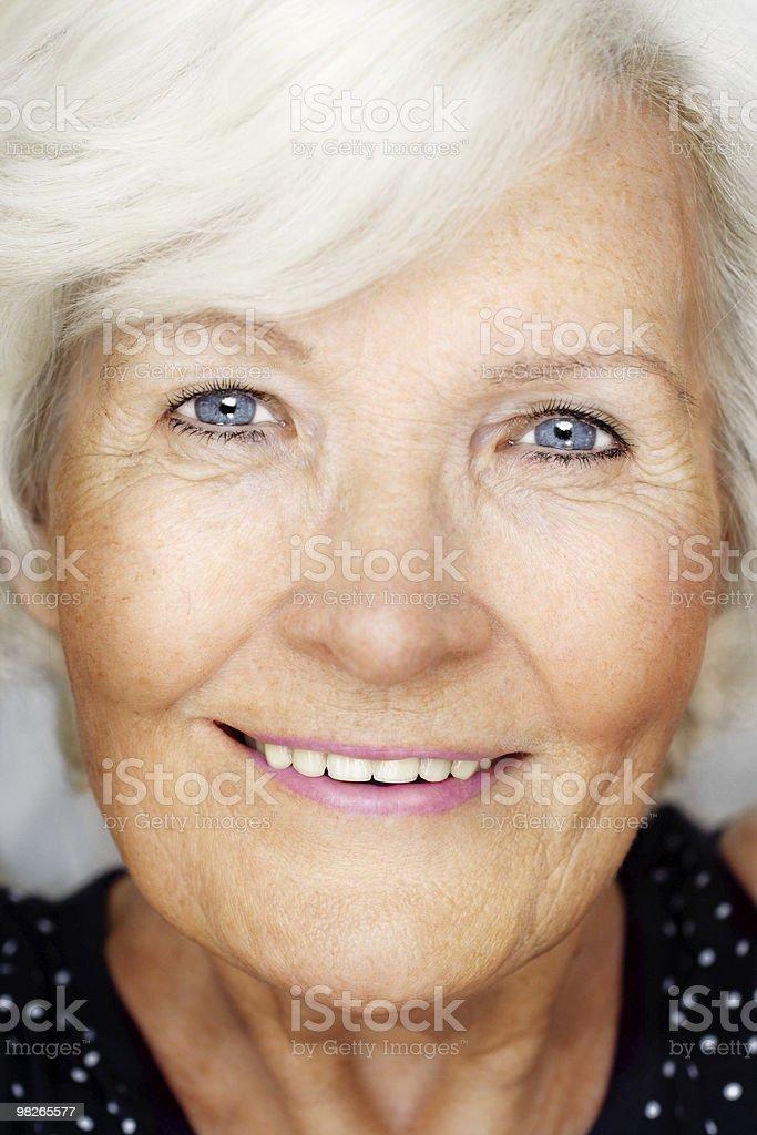 Senior woman looking happy royalty-free stock photo