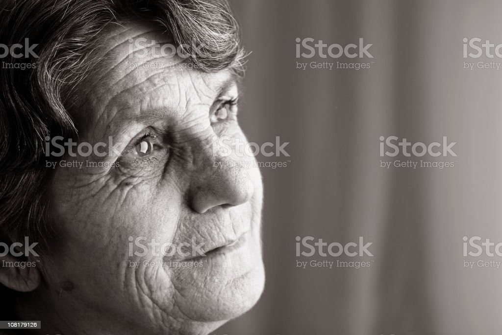 Senior Woman Looking Pensive, Black and White stock photo