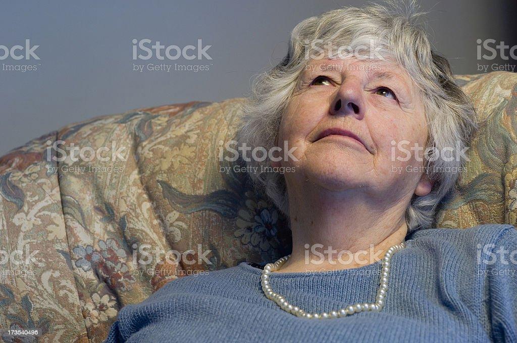 Senior woman looking up royalty-free stock photo