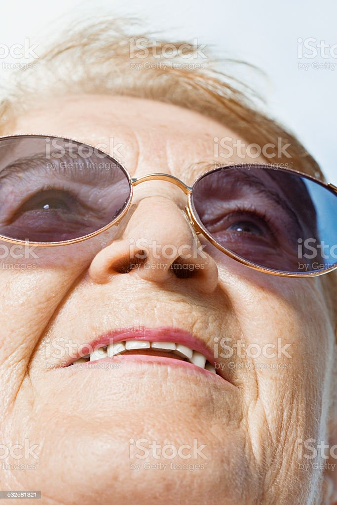 Senior woman looking up stock photo