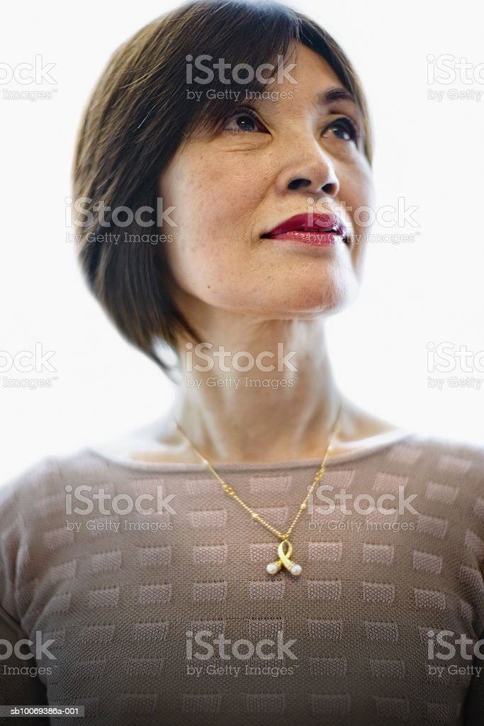 Senior woman looking up, smiling royalty-free stock photo