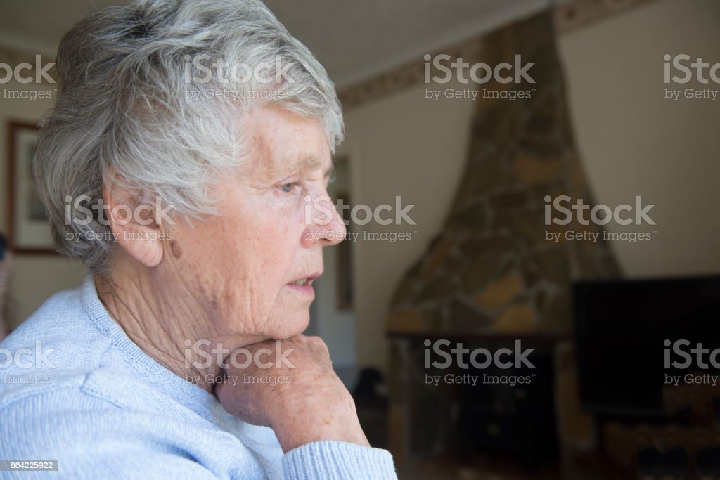 Senior woman looking worried and concerned royalty-free stock photo