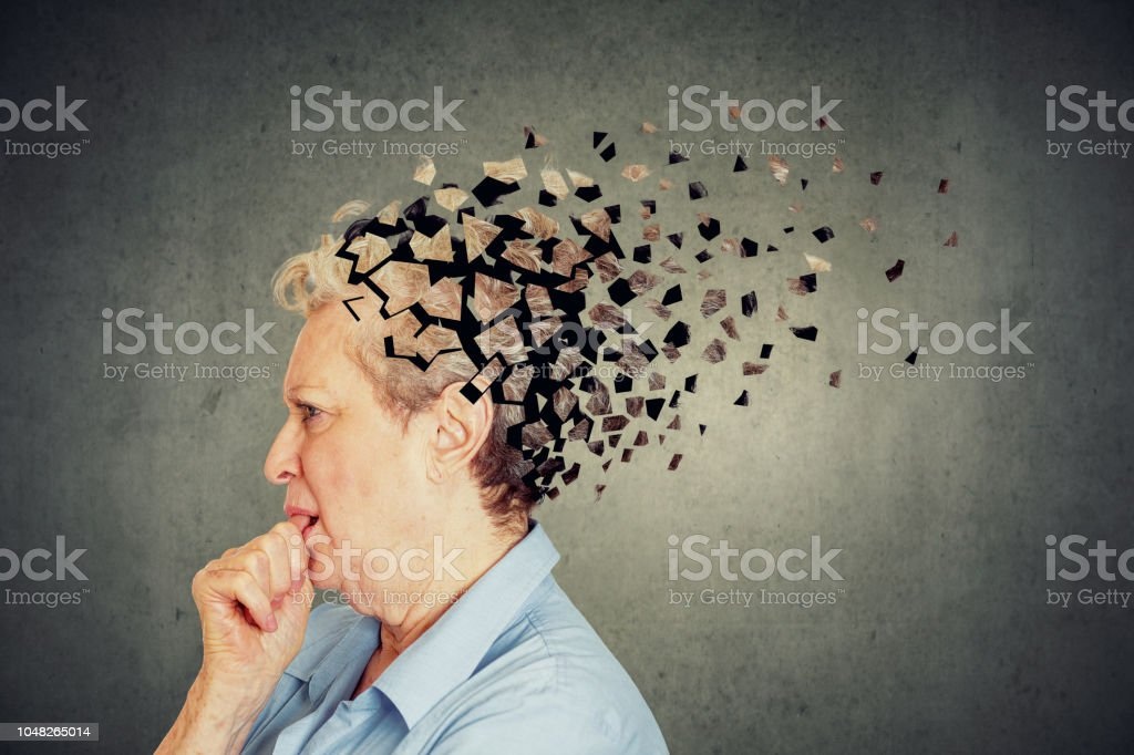 Senior woman losing parts of head feeling confused as symbol of decreased mind function. Memory loss due to dementia. Senior woman losing parts of head feeling confused as symbol of decreased mind function. Activity Stock Photo