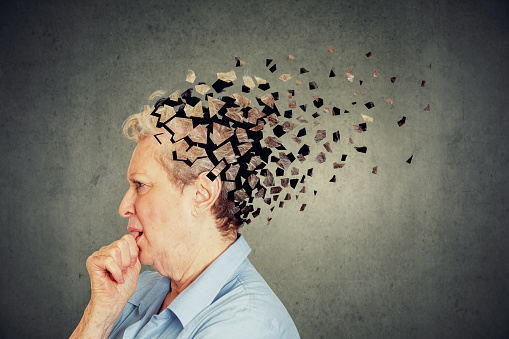 istock Senior woman losing parts of head feeling confused as symbol of decreased mind function. 1048265014