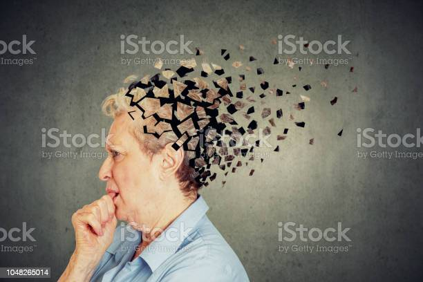 Senior Woman Losing Parts Of Head Feeling Confused As Symbol Of Decreased Mind Function Stock Photo - Download Image Now