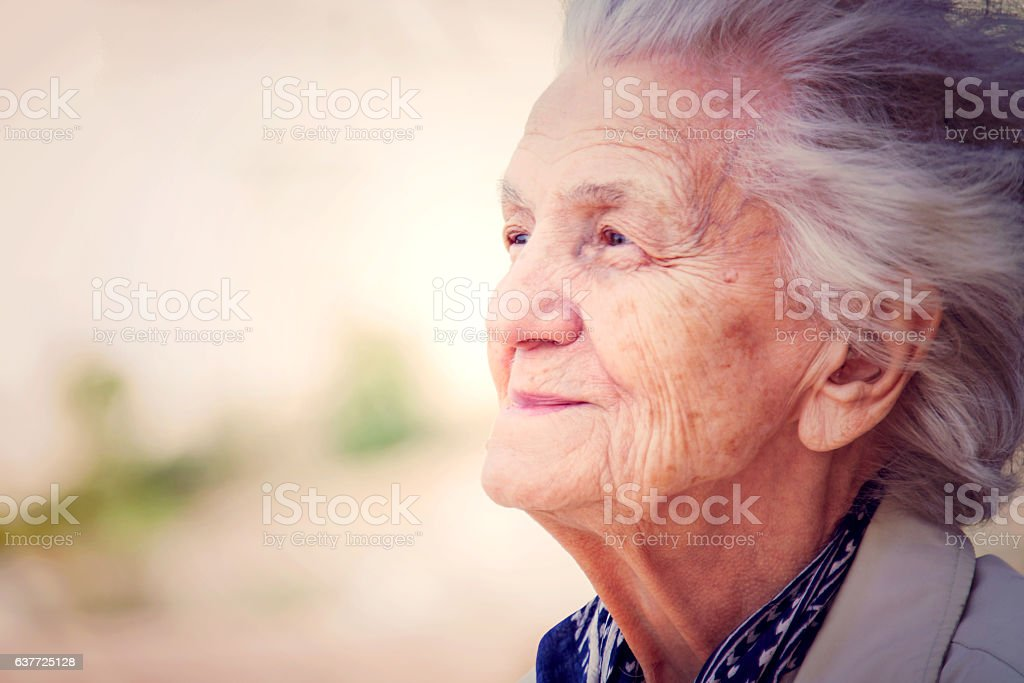 Senior Woman Lost in Thoughts stock photo