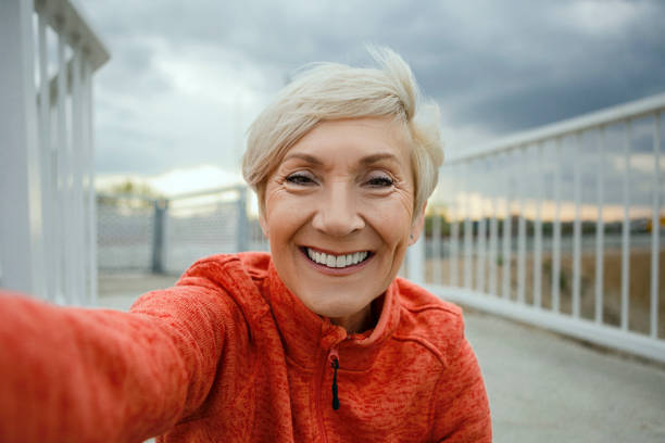 senior woman making a selfie before jogging - self portrait photography stock pictures, royalty-free photos & images