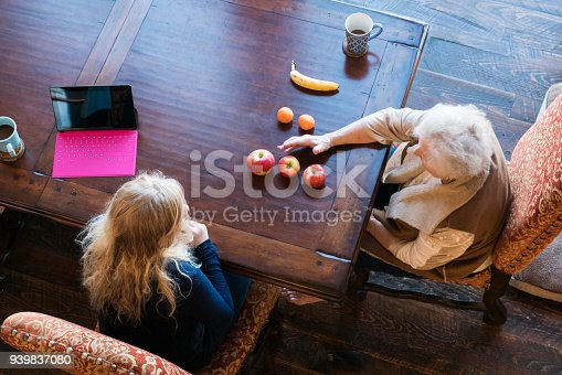 istock Senior woman matches fruit during speech therapy session at home to work on her visual comprehension skills 939837080