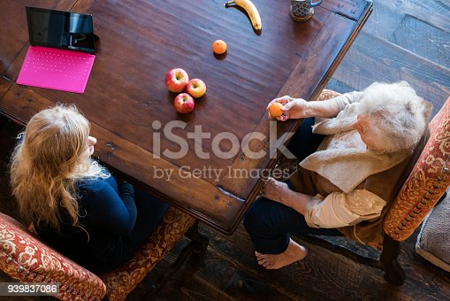 istock Senior woman matches fruit during speech therapy session at home to work on her visual comprehension skills 939837086