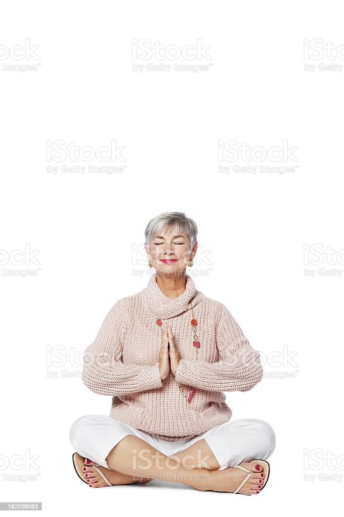 Senior Woman Meditating On Floor royalty-free stock photo
